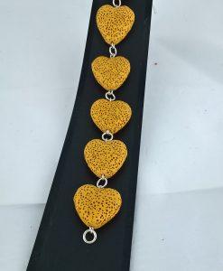 Hjertepallettens sølvarmband med okergule lavahjerter