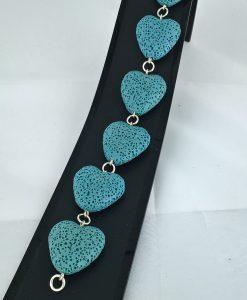 Hjertepallettens sølvarmband med lys blå lava hjerter